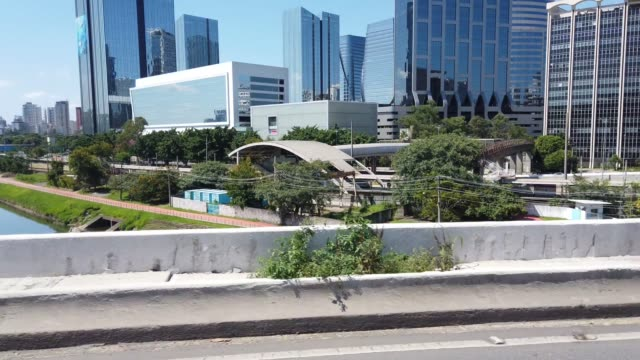 Modern Buildings in Sao Paulo city. Video taken by car passing over Marginal Pinheiros. Video taken in Sao Paulo city. Modern building on background. marginal pinheiros stock videos & royalty-free footage