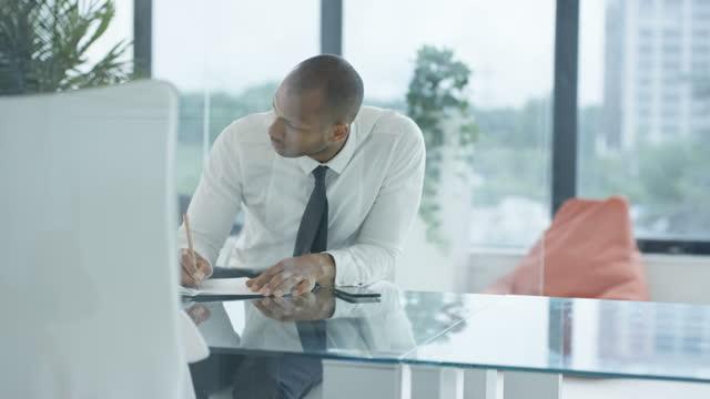 Modern Business Worker in Busy Office video