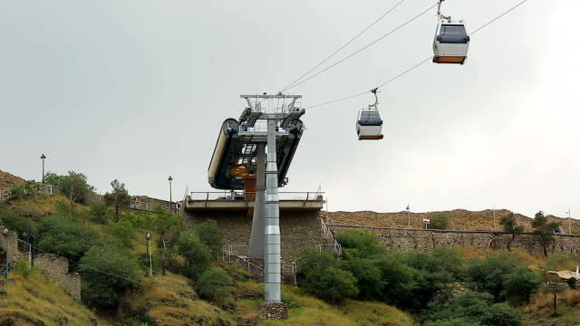 Modern cable car system carrying passengers from city center to park, Tbilisi video