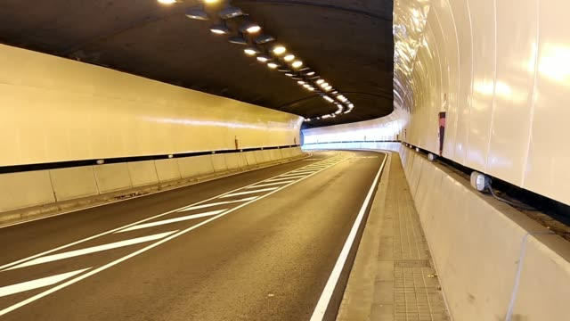 Modern car tunnel with good lighting. Highway road