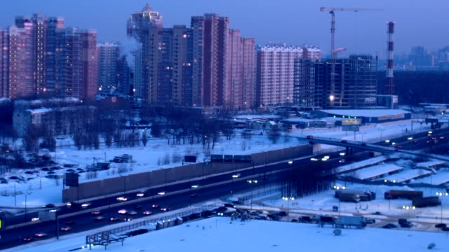 Modern city and movement on high-speed highway nearby. video