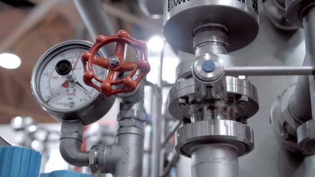 Modern complex technological industrial equipment. A red tap (faucet) video
