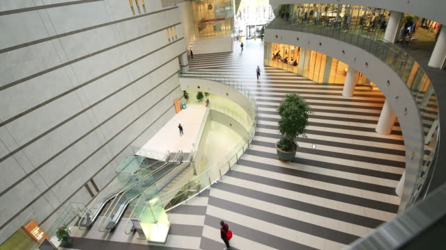 Modern, cool building indoors - Time-lapse of people walking at office hall- High-angle shot video