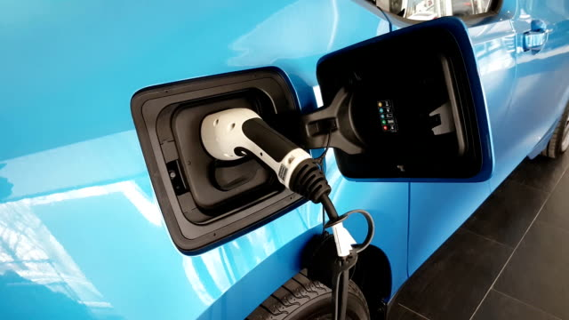 Modern electric car gets energy at some modern power source point in Europe video