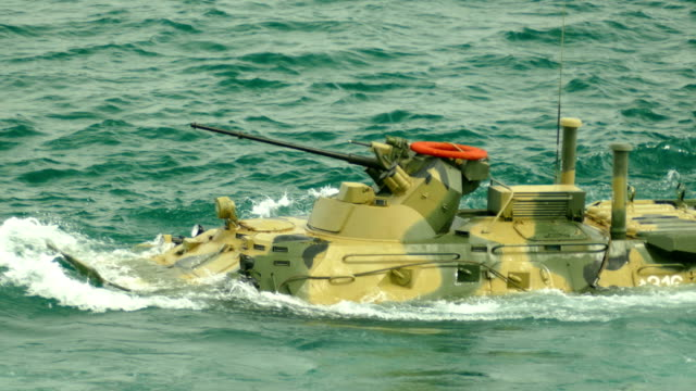 modern floating armored personnel carrier - anfibio video stock e b–roll
