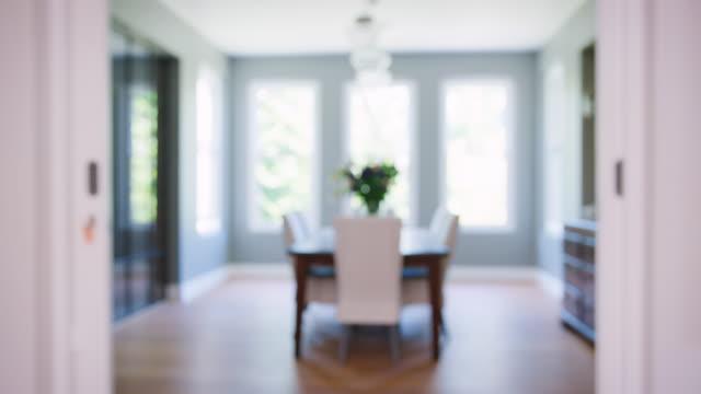 Modern furnished domestic dining room, rack focus shot