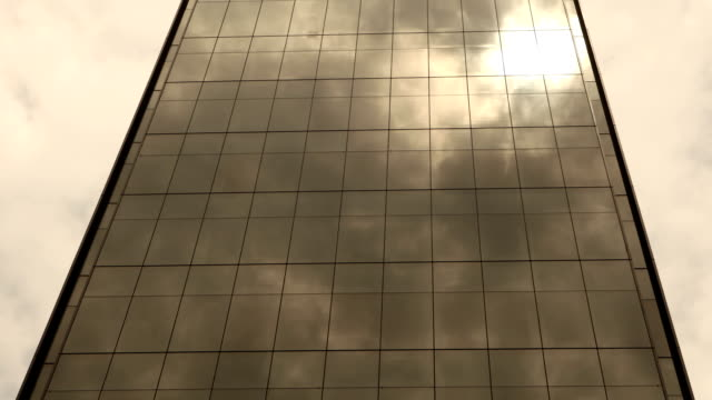 Modern Glass Building Time Lapse Time lapse of clouds and reflection on a modern glass building.  post modern architecture stock videos & royalty-free footage