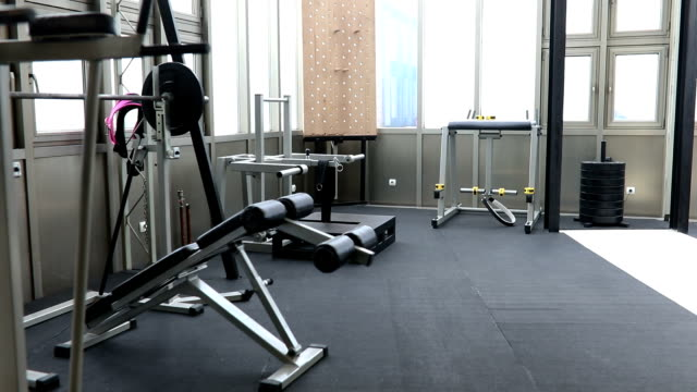 Modern gym Empty modern gym with all exercise equipment. health club stock videos & royalty-free footage
