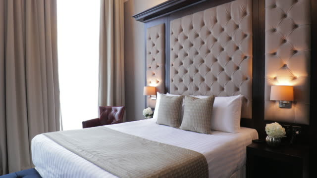 modern hotel bedroom interior - bedroom video stock e b–roll