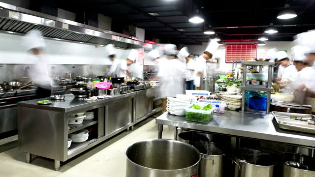 modern kitchen and busy chefs, time lapse. - busy restaurant kitchen stock videos & royalty-free footage