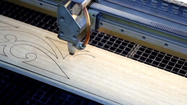 Modern laser woodworking machine with CNC at the woodworking and furniture plant video