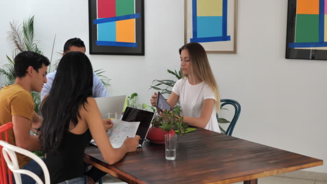 Modern Latin American blockchain investors in office working together