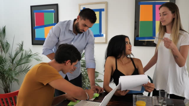 Modern Latin American business people in office working together