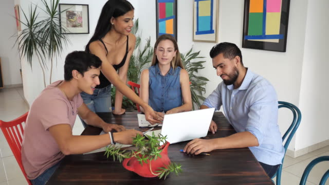 Modern Latin American young business people in office applauding to their colleague