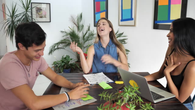 Modern Latin American young entrepreneurs in office working together