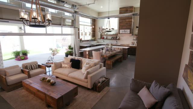 modern living space with patio door closing - affluent lifestyle stock videos and b-roll footage