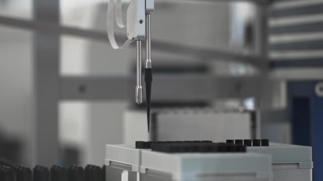 Modern medical tests robotic machine, molecular genetic research laboratory, PCR Medical tests, modern robotic machine, molecular genetic research laboratory, PCR. Automatic pipetting robot analyze DNA to find a treatment. Multishot oncology stock videos & royalty-free footage