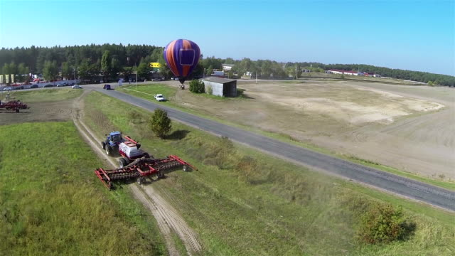 Modern new tractor  and balloon . Aerial video