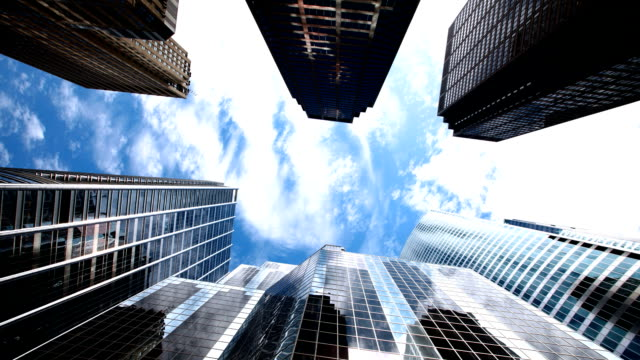 Modern office buildings and clouds video