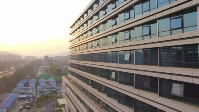 modern office buildings with glass wall in hangzhou 4k video