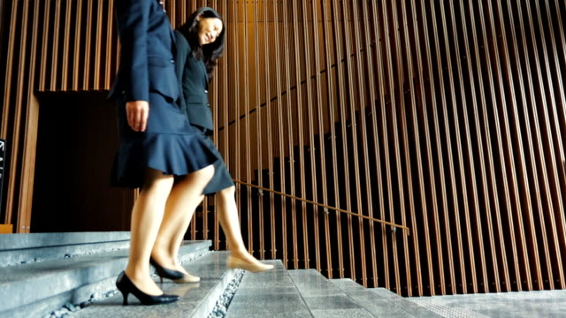 Modern Office Greeting of Women on Stairs in Japan video