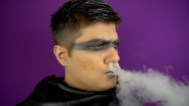 modern punk rocker smoking in slow motion. - gothic fashion stock videos and b-roll footage