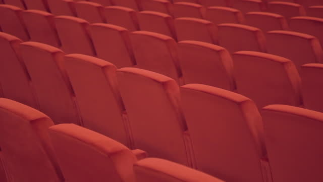 Modern red seat theatre empty space on background for decoration design Interior theater hall