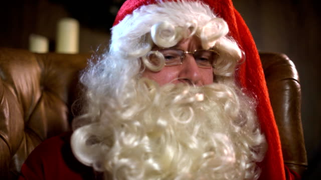 Modern Santa Claus using tablet pc video