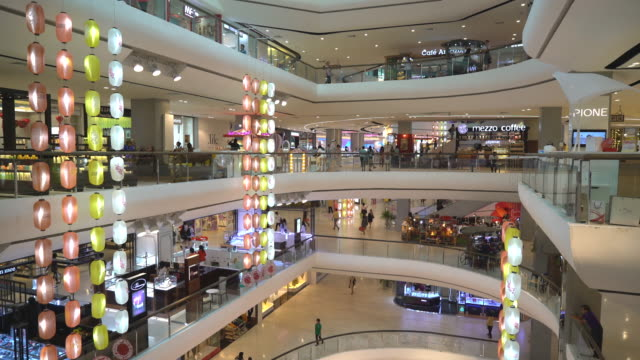 Modern Shopping Mall with stores, Cafe and Shoppers Walking Around video
