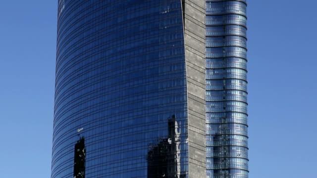 Modern skyscraper in Milan Glass facade modern skyscraper in Milan, Italy. lombardy stock videos & royalty-free footage