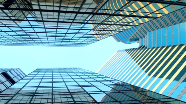 Video Modern skyscrapers in business district against blue sky