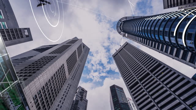 modern smart buildings in CBD of modern city. time lapse hyper lapse modern office buildings in midtown of singapore from low angle. time lapse 4k hyper lapse intelligence stock videos & royalty-free footage
