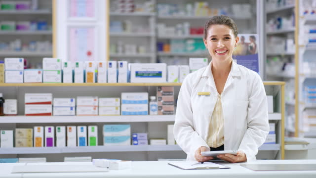 Modern tech makes my job much more exciting 4k video footage of an attractive young female pharmacist using a digital tablet while standing behind the counter in a chemist pharmacy stock videos & royalty-free footage