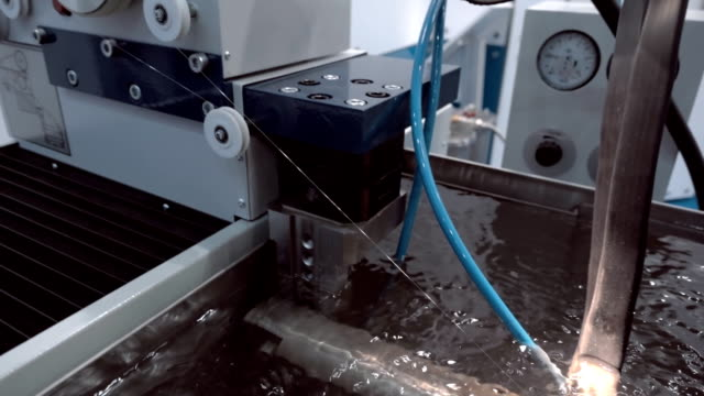 Modern, technological automatic equipment for electrical discharge wire cutting Modern, technological automatic equipment for electrical discharge wire cutting the metal detail. Shot in motion electrode stock videos & royalty-free footage