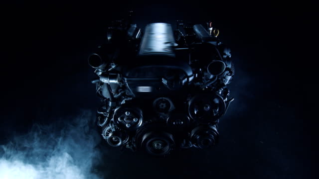 modern technological dark background with an internal combustion engine from car - turbina video stock e b–roll