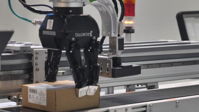 Modern warehouse equipped with robotic arm
