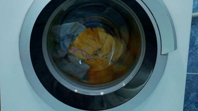 Modern washing machine washes laundry. It very carefully rotates linen. Modern technology of the household. video