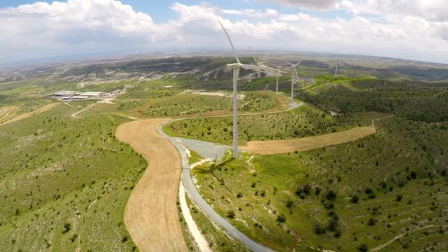 Modern wind turbines generating alternative energy for eco-friendly enterprise video