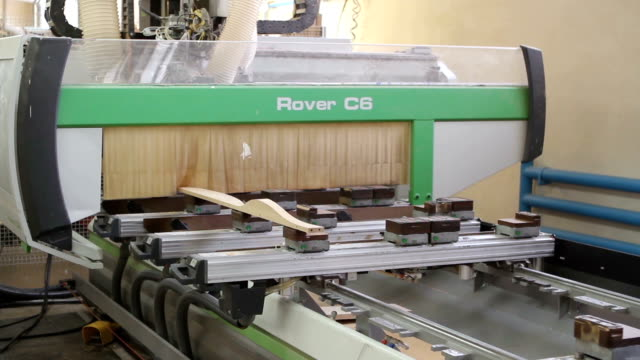 Modern woodworking machine with CNC at the modern woodworking and furniture plant video