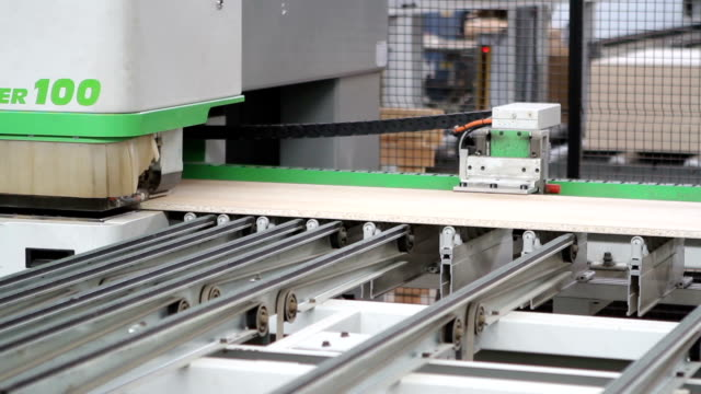 Modern woodworking machine with CNC at the woodworking and furniture plant video