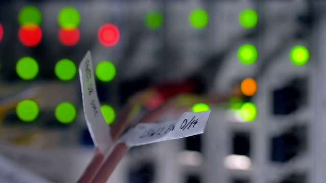 modern working data center servers with cables and lights. backview. 4k. - oggetto creato dall'uomo video stock e b–roll
