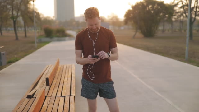 Modern young man working out in an urban park.