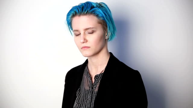 modern youth. calm portrait of a serious girl of unusual appearance with blue hair. modern youth. calm portrait of a serious girl of unusual appearance with blue hair. lesbian stock videos & royalty-free footage
