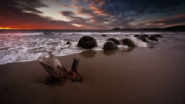 SLOW MOTION: Moeraki Boulders at Sunrise video