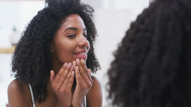 Moisturize and stay fabulous 4k video footage of a beautiful young woman applying moisturizer to her face make up stock videos & royalty-free footage