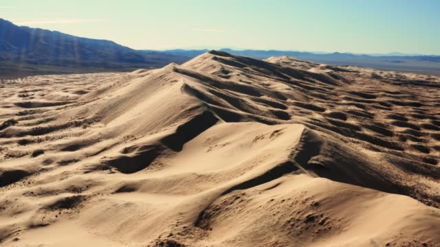 Mojave Desert in California aerial view Mojave Desert in California aerial view, sand dune near Grand Canyon, shooting on drone, hot and dry weather mojave desert stock videos & royalty-free footage