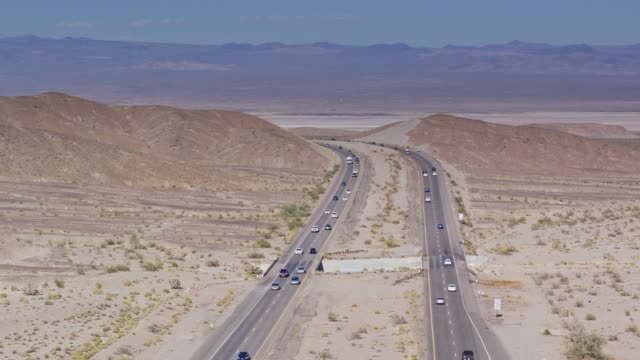 Mojave National Preserve Crossed by I-15 Near Zzyzx - Drone Shot Drone shot of Interstate 15, a divided highway crossing the Mojave Desert near the town of Zzyzx. mojave desert stock videos & royalty-free footage