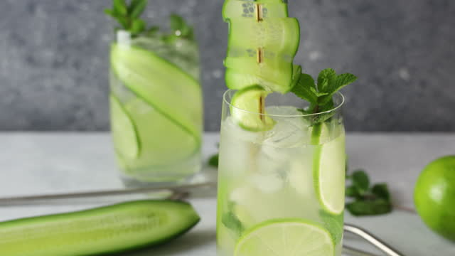 Mojito cocktail or detox cocktail of mint, cucumber and lime video
