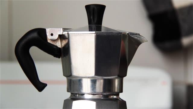 moka coffee maker. close-up. - argento metallo caffettiera video stock e b–roll