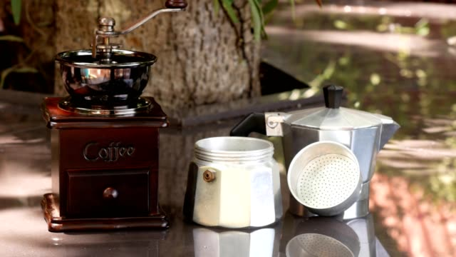 moka pot and coffee grinder